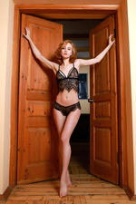 Kitty Nice stands in her doorway dressed-02