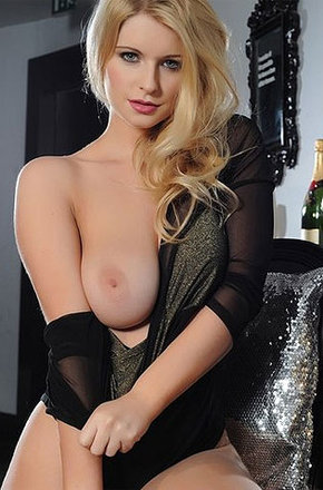 Bustyblonde Removing Her Skirt To Show Her Pair Of Nuts