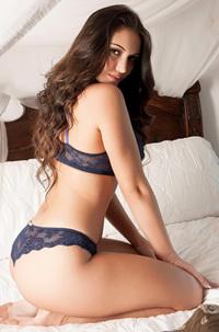Mariane Tarrafel Strips On A Bed